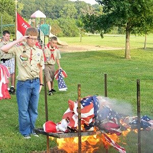 Boyscouts burning flags