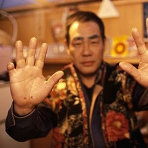 September 1993, Japan --- A member of the Yakuza Mafia displays his hands which are missing most of the pinkies. Fingers are cutoff as a sign of loyalty. --- Image by TWPhoto/Corbis Asia Conformity Human body parts Japan Loyalty