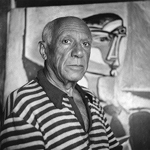 Pablo Picasso...Spanish artist Pablo Picasso (1881 - 1973) in front of one of his paintings at home in Cannes.   (Photo by George Stroud/Getty Images)